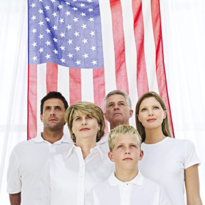 Family Standing in Front of the American Flag